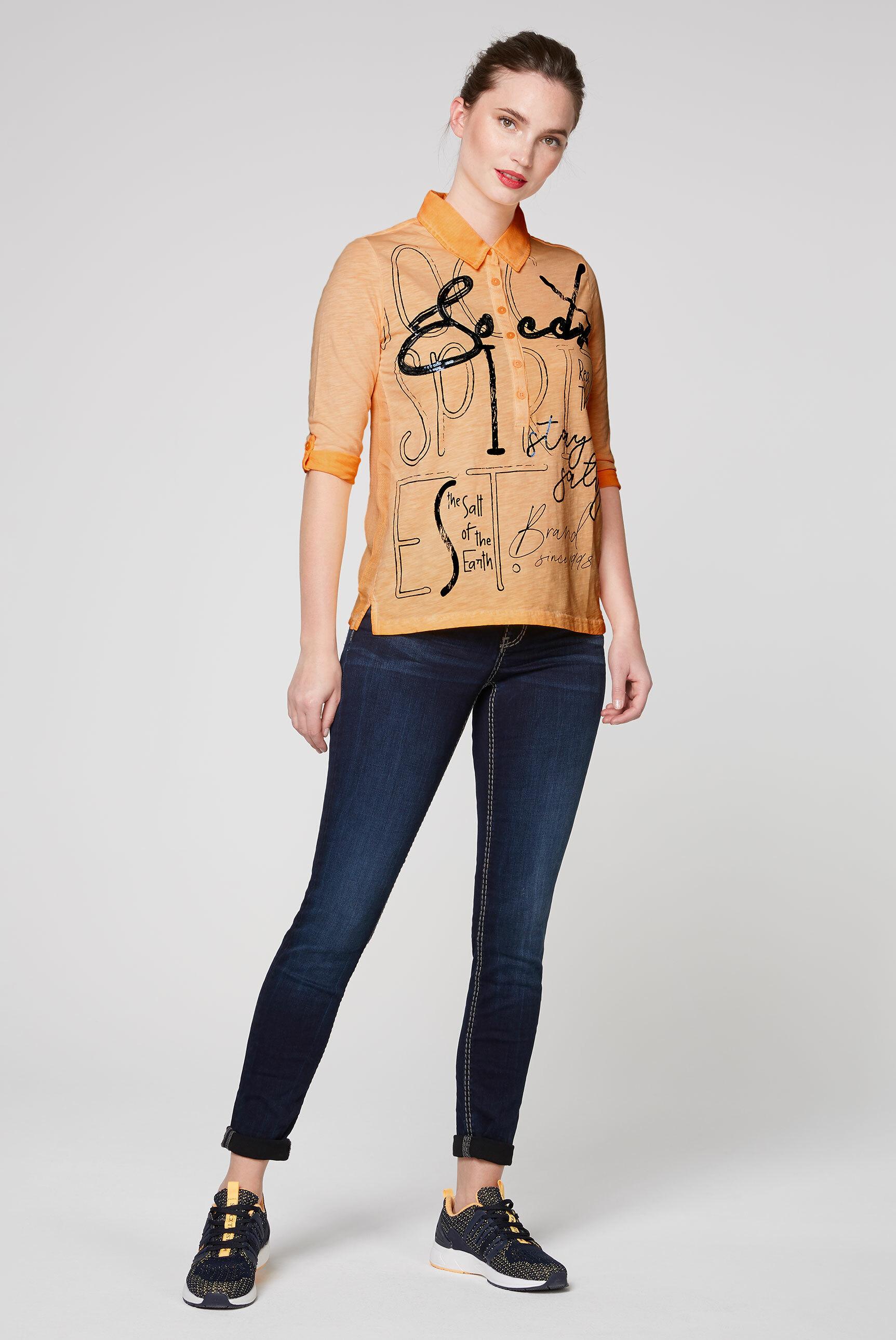 Poloshirt im Materialmix mit Pailletten-Artwork